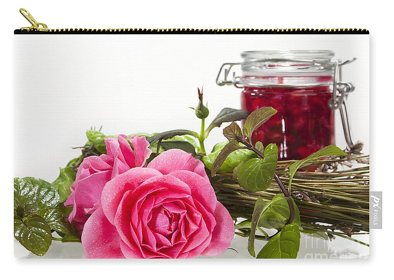 Rose Carry-all Pouch featuring the photograph Oil Mixture Of Essential Oils For Aromatherapeutic Use by Wolfgang Steiner