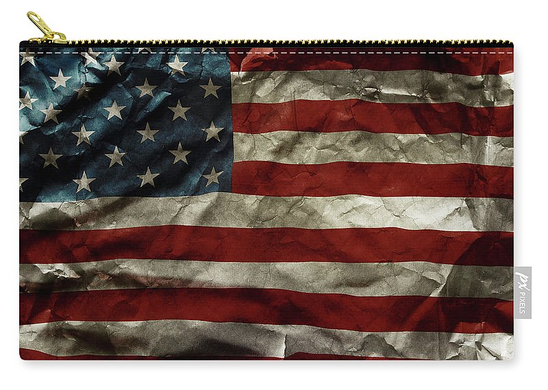 American Flag Carry-all Pouch featuring the photograph American Flag by Les Cunliffe