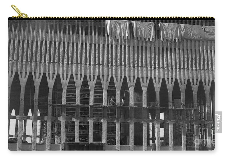 World Trade Center Construction Black And White 1967 Carry-all Pouch featuring the photograph World Trade Center Under Construction 1967 by Bob Bennett