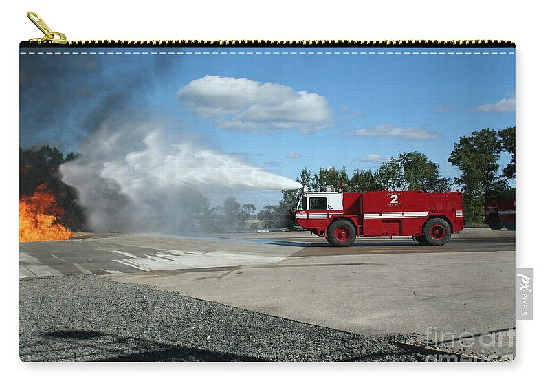 Firefighting Carry-all Pouch featuring the photograph Firefighting by Tommy Anderson