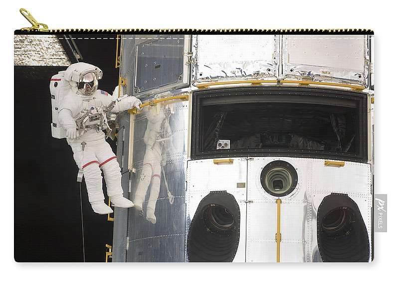 Sts-125 Carry-all Pouch featuring the photograph Astronauts Working On The Hubble Space by Stocktrek Images