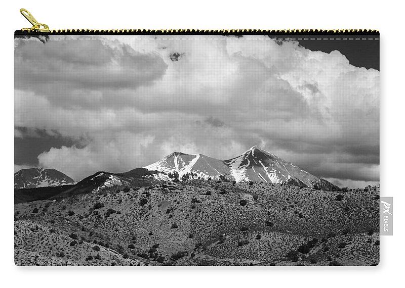 Snow Carry-all Pouch featuring the photograph Canyon Badlands And Colorado Rockies Lanadscape by Alex Grichenko