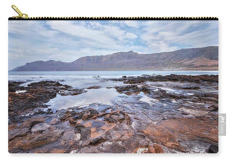 Playa De Famara Carry-all Pouch featuring the photograph Famara - Lanzarote by Joana Kruse