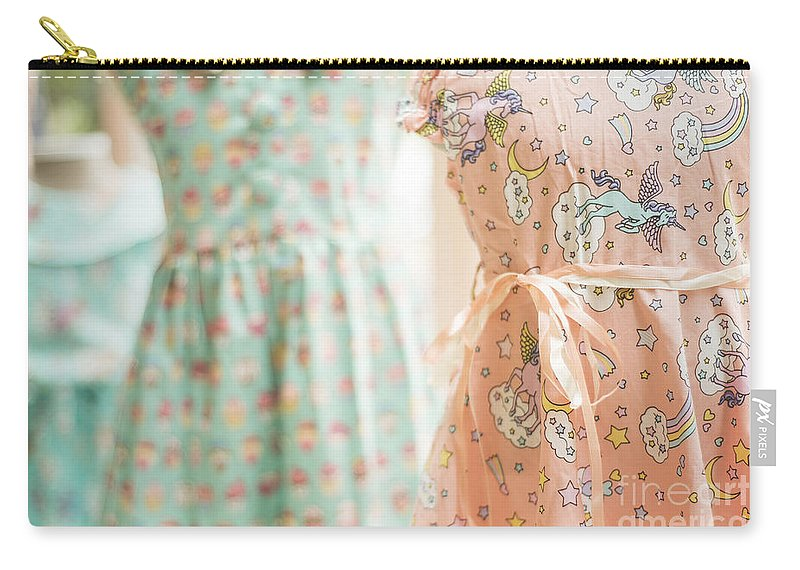 Bright Carry-all Pouch featuring the photograph Floral Pattern Young Girl Dresses In Shop by Jacek Malipan