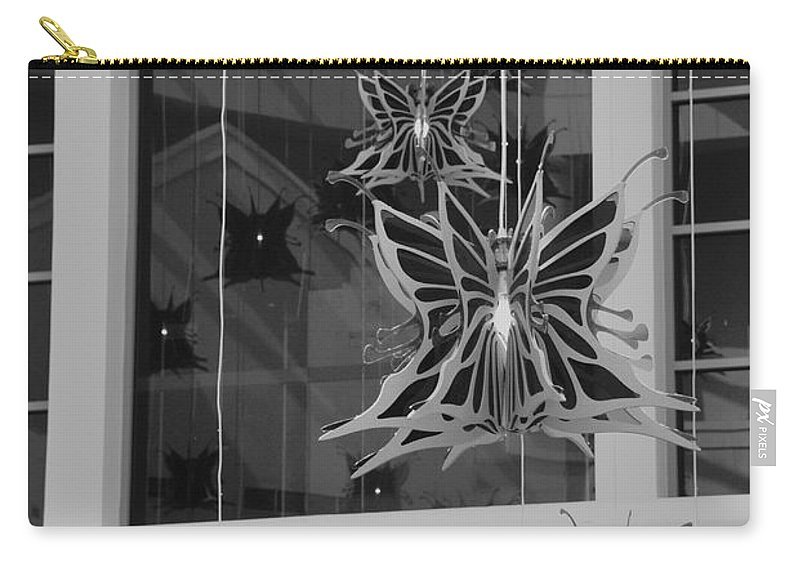 Black And White Carry-all Pouch featuring the photograph Hanging Butterflies by Rob Hans