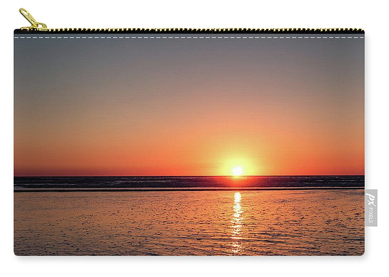 Sunset Carry-all Pouch featuring the photograph Sunset Over The Ocean by Eric Strickland