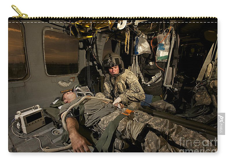 Blackhawk Carry-all Pouch featuring the photograph U.s. Army Specialist Practices Giving by Terry Moore