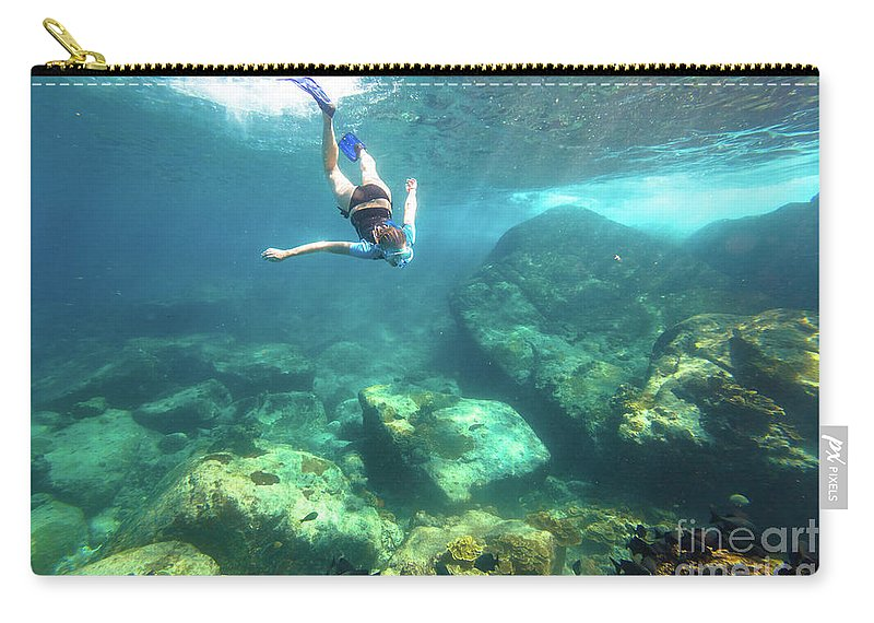 Snorkeling Carry-all Pouch featuring the photograph Woman Free Diving by Benny Marty