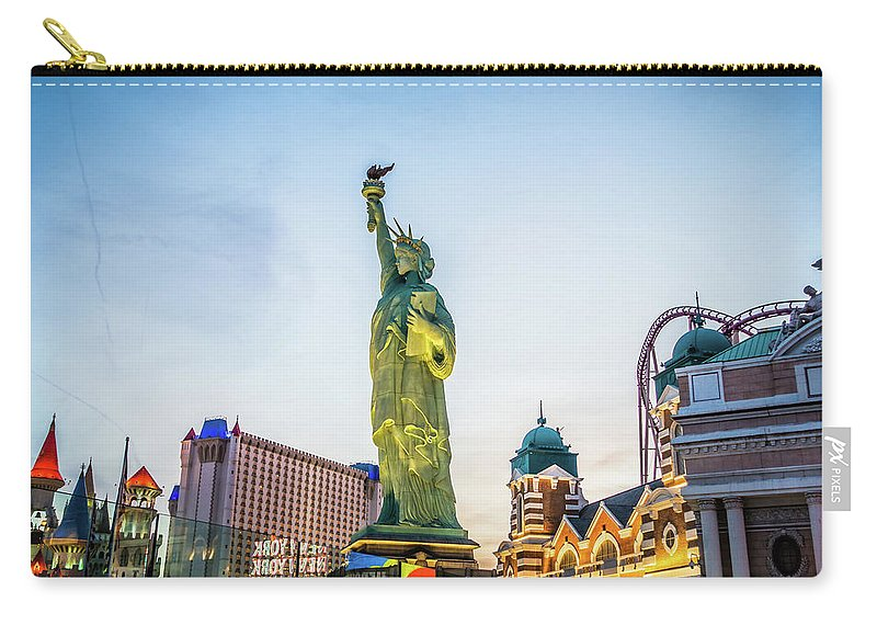 Illumination Carry-all Pouch featuring the photograph Street Scenes Around Las Vegas Nevada At Dusk by Alex Grichenko