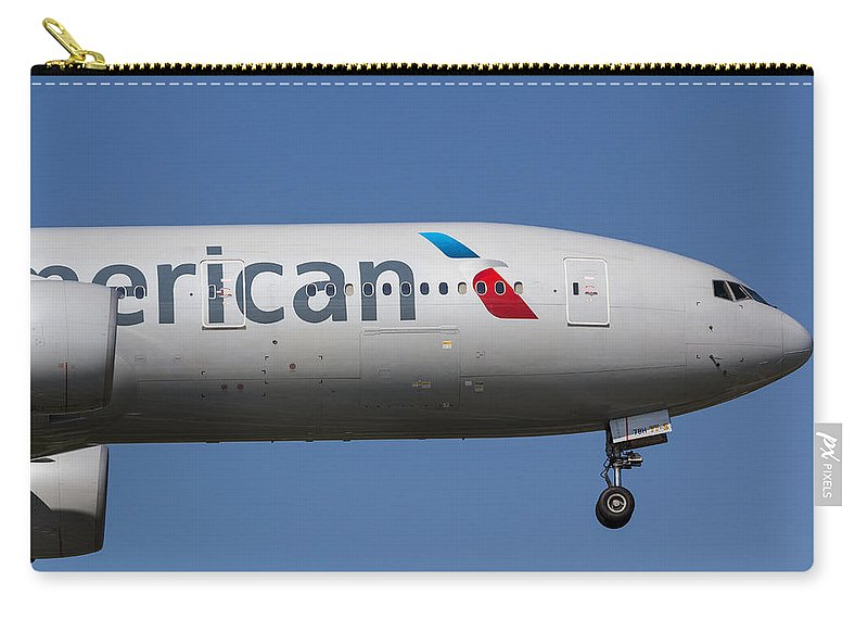 American Carry-all Pouch featuring the photograph American Airlines Boeing 777 by David Pyatt