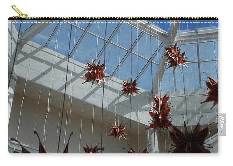 Architecture Carry-all Pouch featuring the photograph Hanging Butterflies by Rob Hans