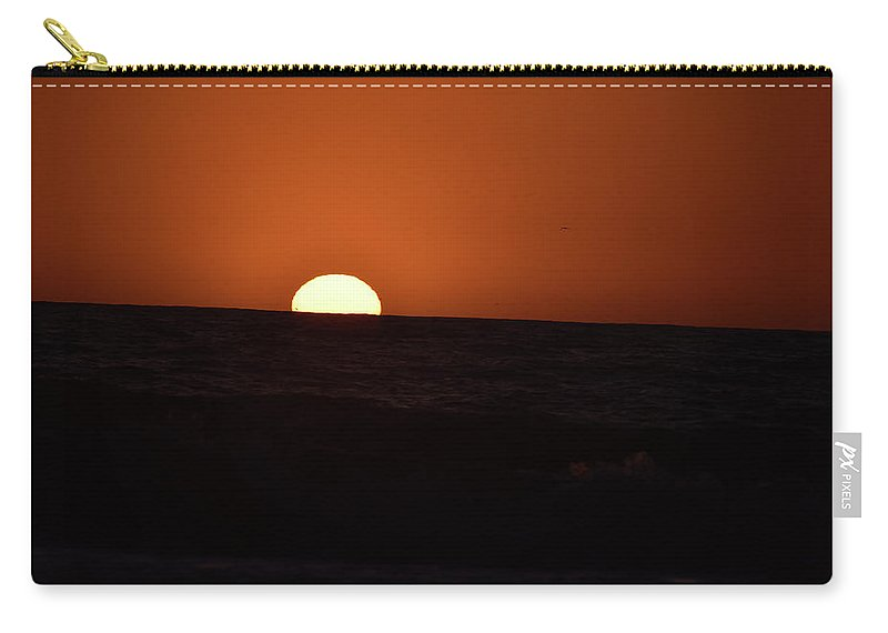 Pacific Ocean Carry-all Pouch featuring the photograph Sun Sinking Into Pacific Ocean by Debra Wales