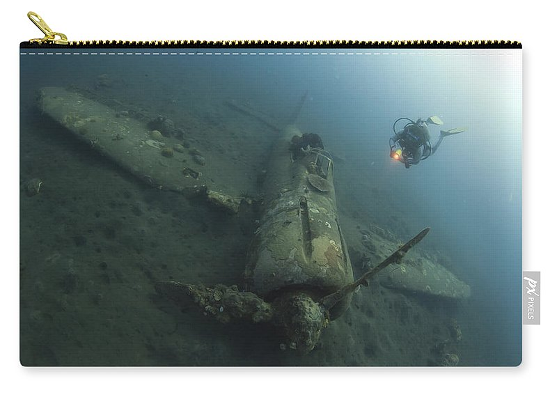 Kimbe Bay Carry-all Pouch featuring the photograph Diver Explores The Wreck by Steve Jones
