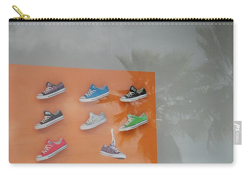 Orange Carry-all Pouch featuring the photograph 8 Sneakers by Rob Hans