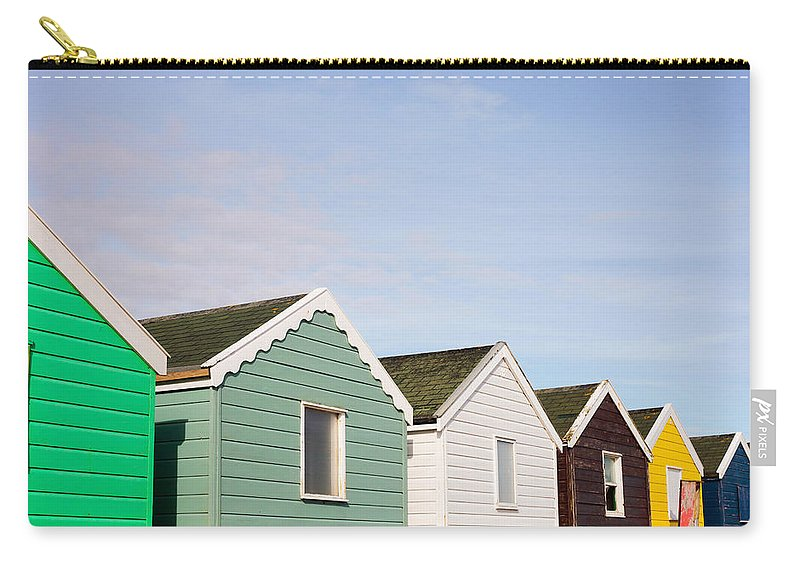 Southwold Carry-all Pouch featuring the photograph Beach Huts by Tom Gowanlock