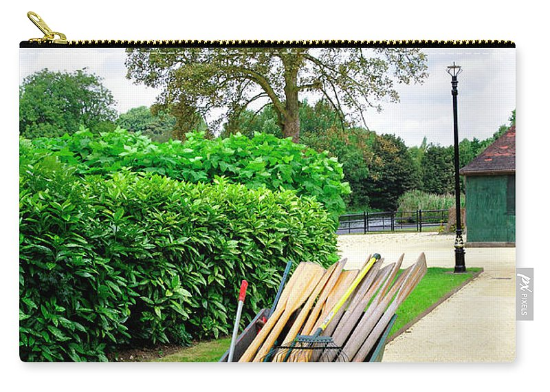 Laurel Carry-all Pouch featuring the photograph A Barrow Load Of Oars by Rod Johnson