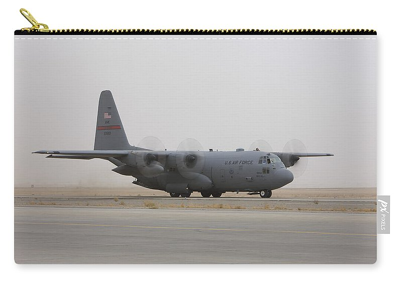 Aviation Carry-all Pouch featuring the photograph A C-130 Hercules Aircraft Taxis by Terry Moore