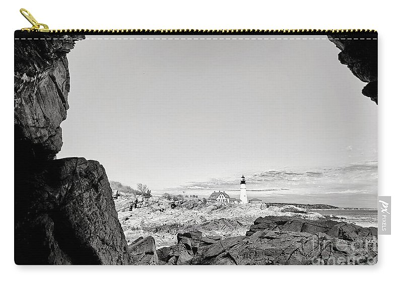 Portland Head Lighthouse Carry-all Pouch featuring the photograph A Glimpse Of The Lighthouse by Susan Garver