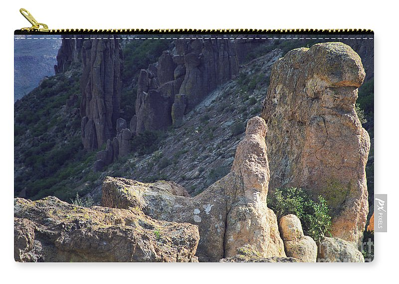 Rock Formations Carry-all Pouch featuring the photograph A Hard Ride by Kathy McClure