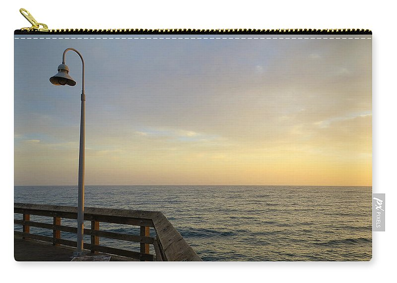 Ventura Carry-all Pouch featuring the photograph A Lamp Before Sunset by Rachel Morrison