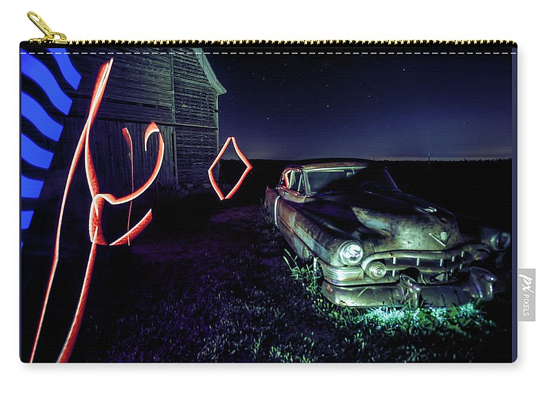 Rusty Car Carry-all Pouch featuring the photograph A Light Painted Scene Of A Rusty Caddy By A Barn And Cornfield by Sven Brogren