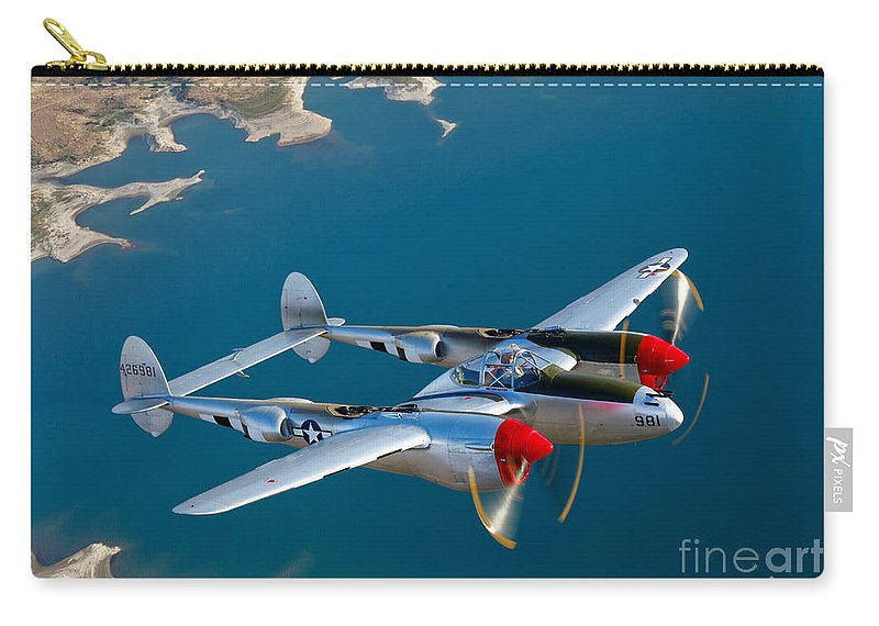 World War Ii Carry-all Pouch featuring the photograph A Lockheed P-38 Lightning Fighter by Scott Germain