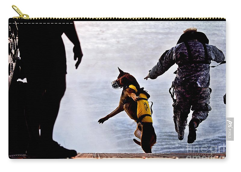 Military Carry-all Pouch featuring the photograph A U.s. Soldier And His Military Working by Stocktrek Images