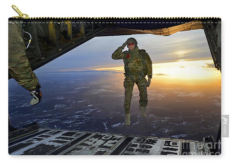 C-130 Carry-all Pouch featuring the photograph A U.s. Soldier Salutes His Fellow by Stocktrek Images