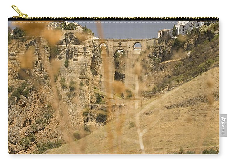 Tajo Carry-all Pouch featuring the photograph A View Of The Tajo De Ronda And Puente Nuevo Bridge Serrania De Ronda Andalucia Spain by Mal Bray