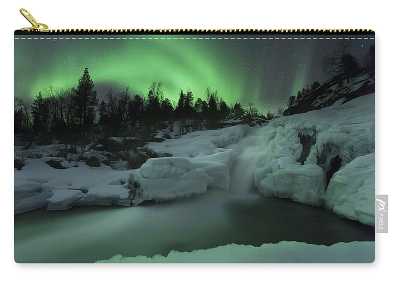 Green Carry-all Pouch featuring the photograph A Wintery Waterfall And Aurora Borealis by Arild Heitmann