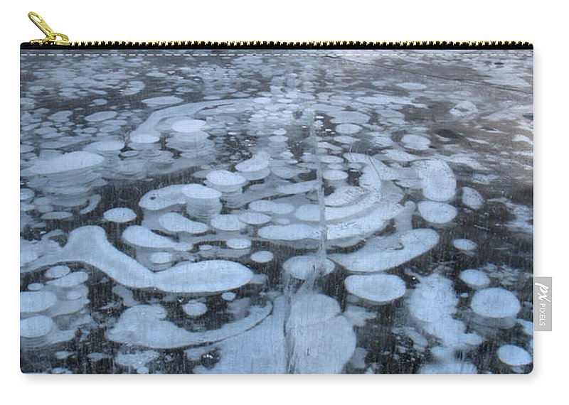 Abraham Lake Carry-all Pouch featuring the photograph Abraham Lake Ice Bubbles by Adam Jewell