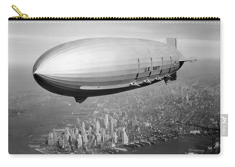 Uss Macon Carry-all Pouch featuring the photograph Airship Flying Over New York City by War Is Hell Store
