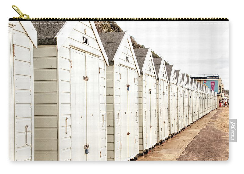All In A Row Carry-all Pouch featuring the photograph All In A Row by Phyllis Taylor