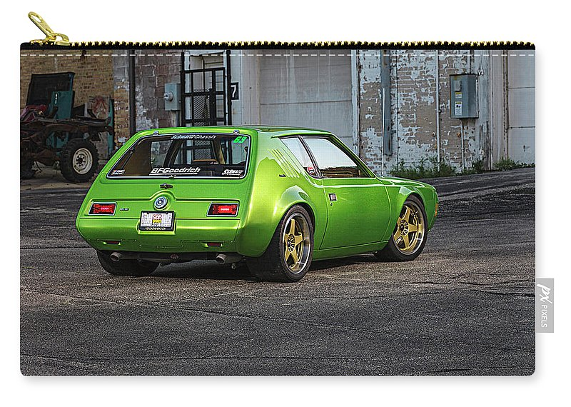 Amc Gremlin Carry-all Pouch featuring the photograph Amc Gremlin by Jackie Russo