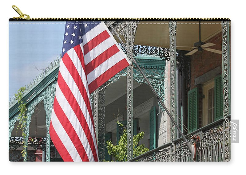 American Flag Carry-all Pouch featuring the photograph American French Quarter by Lauri Novak