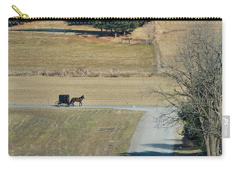 Amish Horse And Buggy In Ohio Carry-all Pouch featuring the photograph Amish Horse And Buggy On A Country Road by Dan Sproul