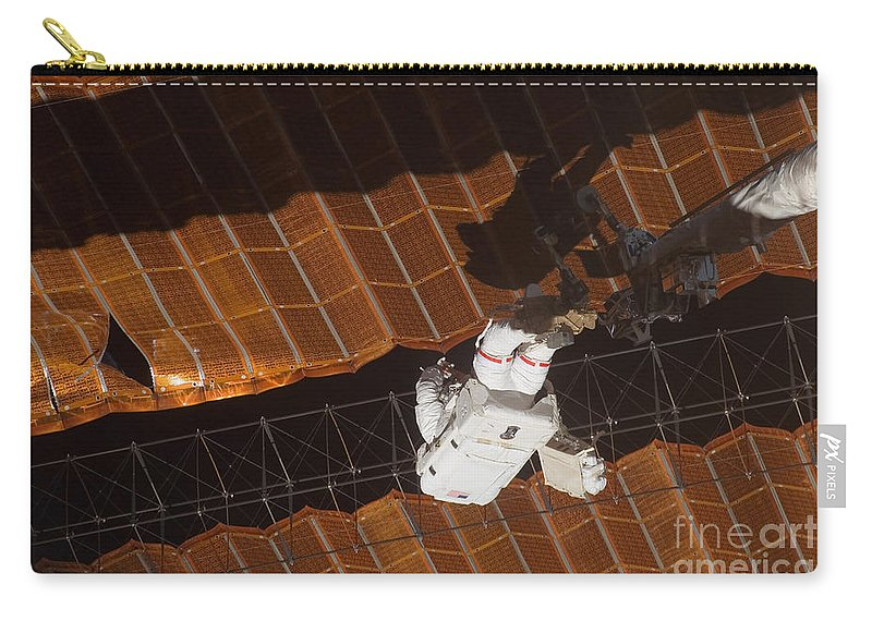 Adults Only Carry-all Pouch featuring the photograph An Astronaut Anchored To A Foot by Stocktrek Images