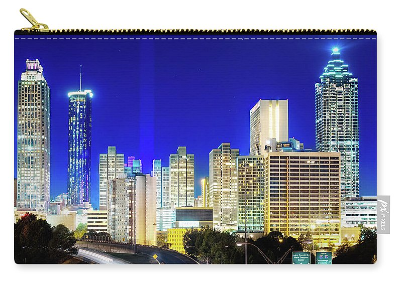 Atlanta Carry-all Pouch featuring the photograph An Evening In Atlanta by Mark Andrew Thomas