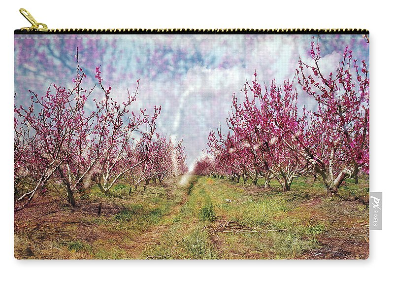 An Orchard In Blossom In The Golan Heights Carry-all Pouch featuring the photograph An Orchard In Blossom In The Golan Heights by Dubi Roman