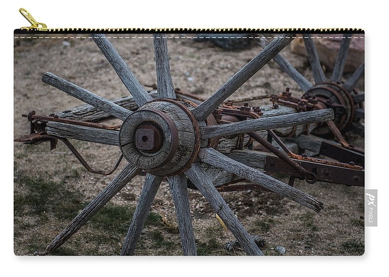 Antique Wagon Wheel Carry-all Pouch featuring the photograph Antique Wagon Wheel by Paul Freidlund