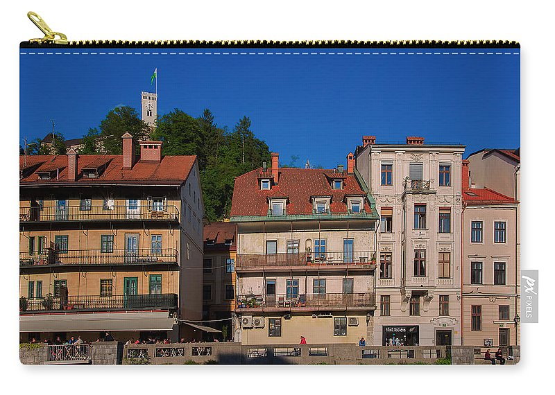 Apartment Carry-all Pouch featuring the photograph Apartments By The Ljubljanica River In Ljubljana by Blaz Gvajc