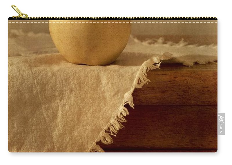 Dining Room Carry-all Pouch featuring the photograph Apple Pear On A Table by Priska Wettstein
