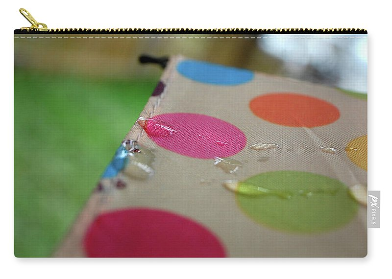 Nature Carry-all Pouch featuring the photograph April Showers by Jacqueline Dickens
