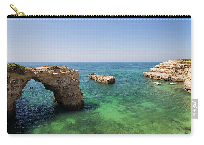 Albandeira Carry-all Pouch featuring the photograph Arch Of Albandeira Beach by Moura Pereira