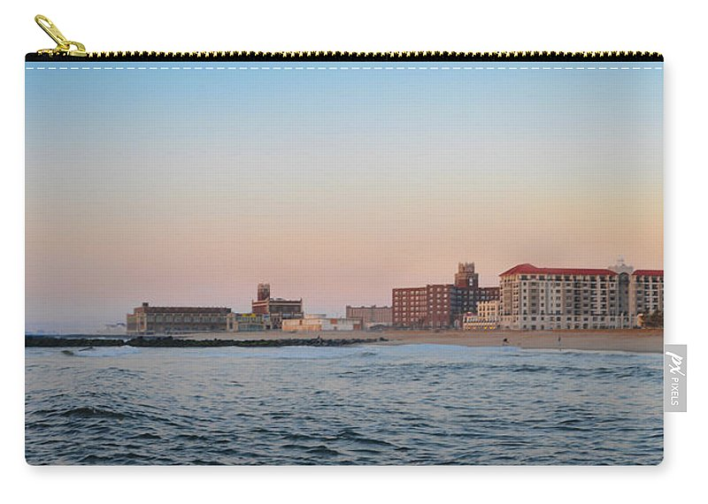 Asbury Carry-all Pouch featuring the photograph Asbury Park Boardwalk From The Beach by Bill Cannon