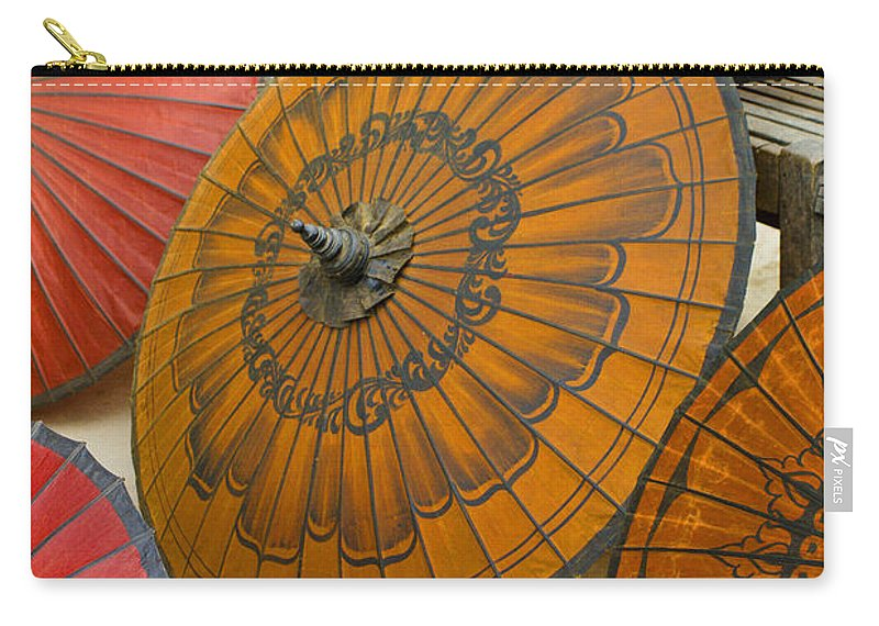 Oriental Carry-all Pouch featuring the photograph Asian Umbrellas by Michele Burgess