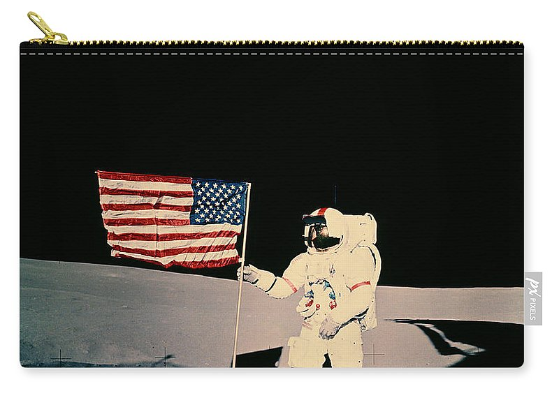 Apollo 14 Carry-all Pouch featuring the photograph Astronaut With Us Flag On Moon by Nasa
