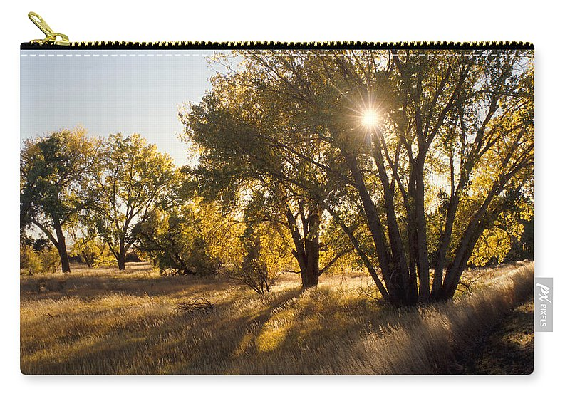 Fall Carry-all Pouch featuring the photograph Autum Sunburst by Jerry McElroy