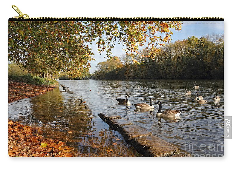 Autumn Colours At Sunbury On Thames Surrey Uk River Leaves The Surrey Countryside Carry-all Pouch featuring the photograph Autumn Colours At Sunbury On Thames Surrey Uk by Julia Gavin
