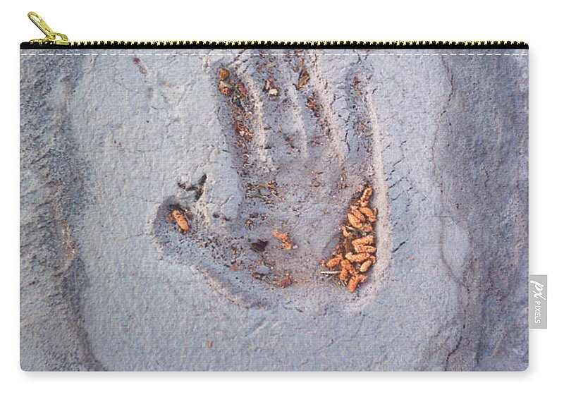 Carry-all Pouch featuring the photograph Autumns Child Or Hand In Concrete by Heather Kirk